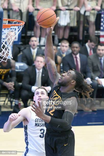 Mo AlieCox of the Virginia Commonwealth Rams drives to the basket during a college basketball game against the George Washington Colonials at the...