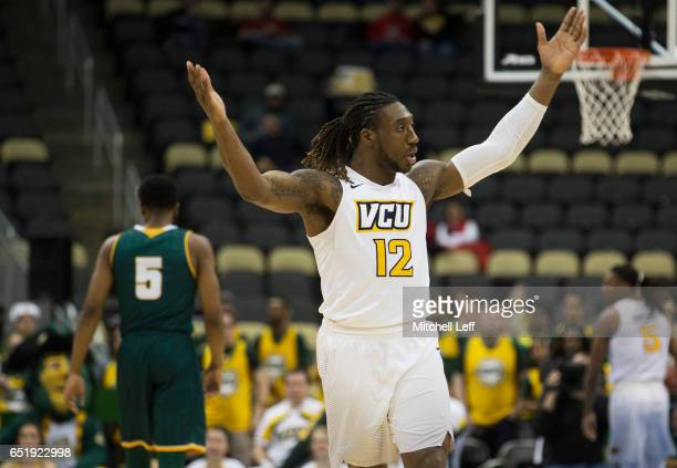 Mo AlieCox of the Virginia Commonwealth Rams reacts in front of Jaire Grayer of the George Mason Patriots in the Quarterfinals of the men's Atlantic...