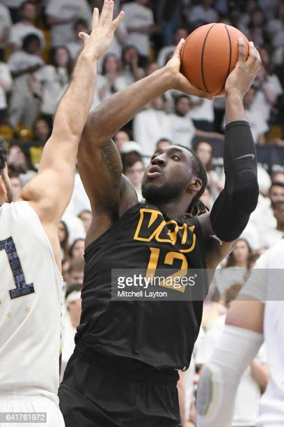 Mo AlieCox of the Virginia Commonwealth Rams takes a shot during a college basketball game against the George Washington Colonials at the Smith...
