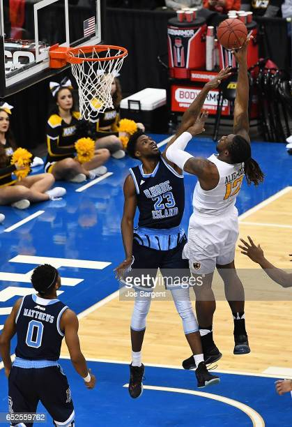 Mo AlieCox of the Virginia Commonwealth Rams takes a shot over Kuran Iverson of the Rhode Island Rams during the championship game of the Atlantic 10...