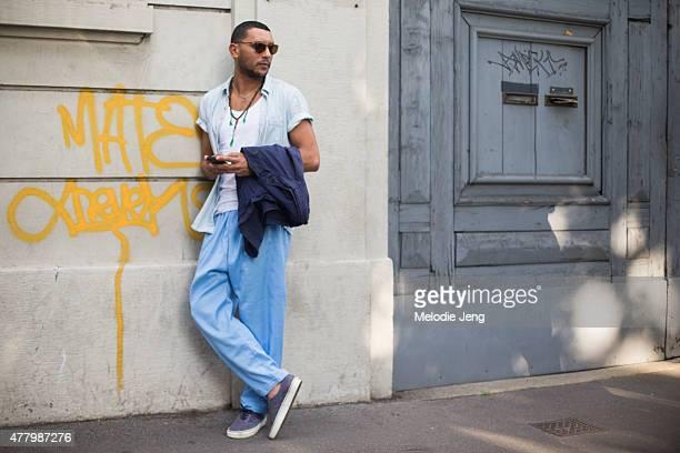 Mo Anwar poses during Milan Men's Fashion Week Spring/Summer 2016 on June 20 2015 in Milan Italy