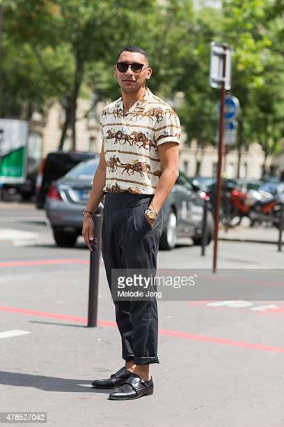Mo Anwar wears Dior Homme sunglasses a vintage Ralph Lauren shirt Comme des Garcons pants and Prada shoes on June 25 2015 in Paris France