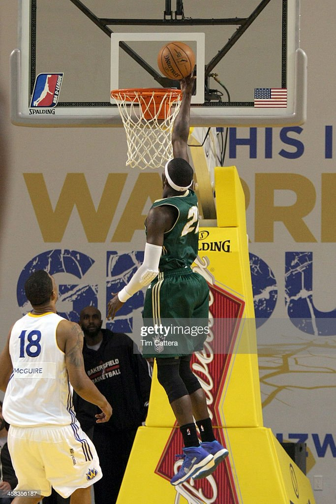 Mo Charlo of the Reno Big Horns shoots a layup against Dominic McGuire of the Santa Cruz Warriors on January 31 2014 at Kaiser Permanente Arena in...