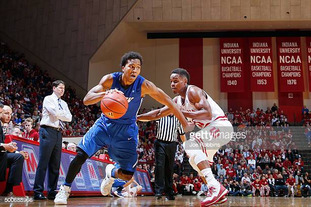 Mo Evans of the IPFW Mastodons drives to the basket against Yogi Ferrell of the Indiana Hoosiers in the second half of the game at Assembly Hall on...