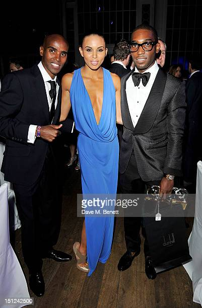 Mo Farah Louise Hazel and Tinie Tempah attend an afterparty following the GQ Men Of The Year Awards 2012 at The Royal Opera House on September 4 2012...
