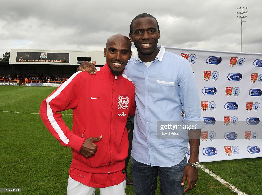 Mo Farah manager of Arsenal Legends XI and Fabrice Muamba anager of World Refugee Internally Displaced Persons XI pose together at the charity...