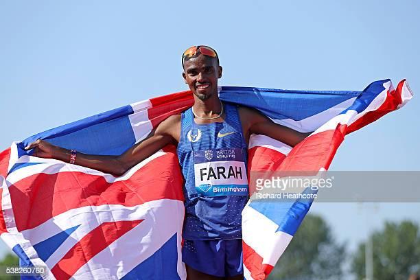 Mo Farah of GB celebrates setting a new British 3000m record during the IAAF Diamond League meeting at Alexander Stadium on June 5 2016 in Birmingham...