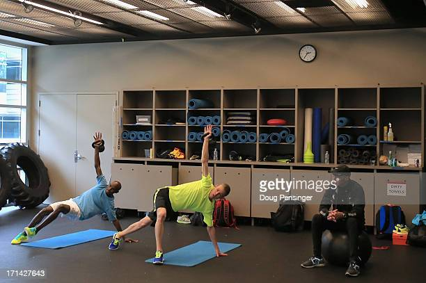 Mo Farah of Great Britain and Galen Rupp of the USA members of the Oregon Project do some cross training as coach Alberto Salazar watches at the Nike...