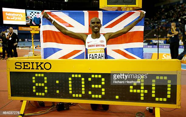 Mo Farah of Great Britain and Northern Ireland celebrates as he wins the Mens 2 Miles final and breaks the World Record during the Sainsbury's Indoor...