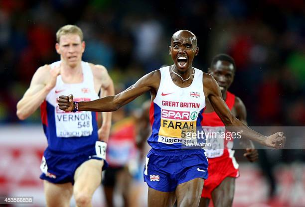 Mo Farah of Great Britain and Northern Ireland celebrates winning gold as Andy Vernon of Great Britain and Northern Ireland wins silver in the Men's...