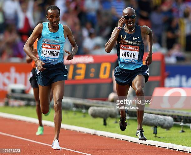 Mo Farah of Great Britain breaks clear to win the Mens 500m during the Sainsbury's Grand Prix Birmingham IAAF Diamond League at Alexander Stadium on...