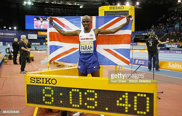 Mo Farah of Great Britain celebrates as he crosses the line in a world record time to win the mens 2 mile race during the Sainsbury's Indoor Grand...