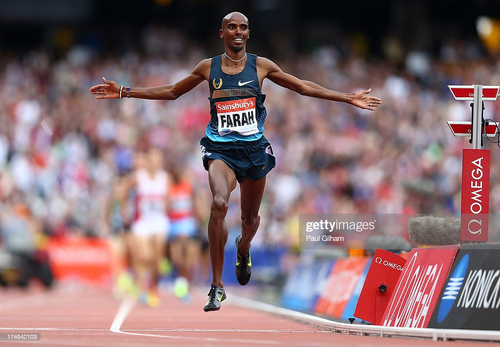 <a gi-track='captionPersonalityLinkClicked' href=/galleries/search?phrase=Mo+Farah&family=editorial&specificpeople=4819130 ng-click='$event.stopPropagation()'>Mo Farah</a> of Great Britain celebrates as he crosses the line in first place in the Men's 3000m during day two of the Sainsbury's Anniversary Games - IAAF Diamond League 2013 at The Queen Elizabeth Olympic Park on July 27, 2013 in London, England.