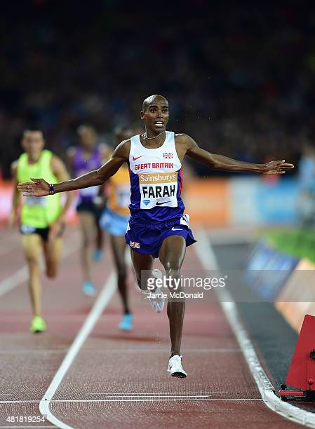 Mo Farah of Great Britain celebrates as he crosses the line to win the Mens 3000m during day one of the Sainsbury's Anniversary Games at The Stadium...