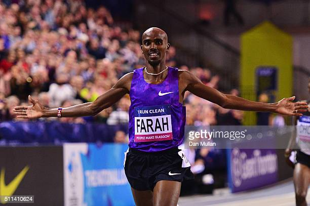 Mo Farah of Great Britain celebrates as he crosses the line to win the Men's 3000 metres final during the Glasgow Indoor Grand Prix at Emirates Arena...