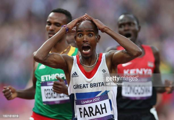 Mo Farah of Great Britain celebrates victory in the men's 5000m Final during the 2012 London Olympics at The Olympic Stadium on August 11 2012 in...