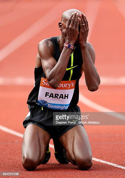 Mo Farah of Great Britain celebrates winning the Men's 2 Mile event with a new british record during the Sainsbury's Birmingham Grand Prix Diamond...