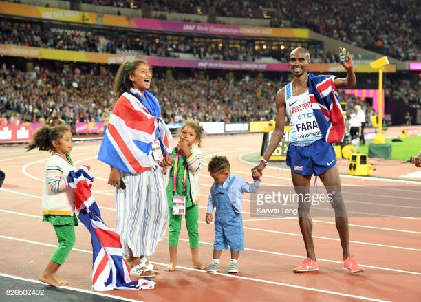 Mo Farah of Great Britain celebrates with his family after winning the men's 10000 metres during the IAAF World Athletics Championships at the London...