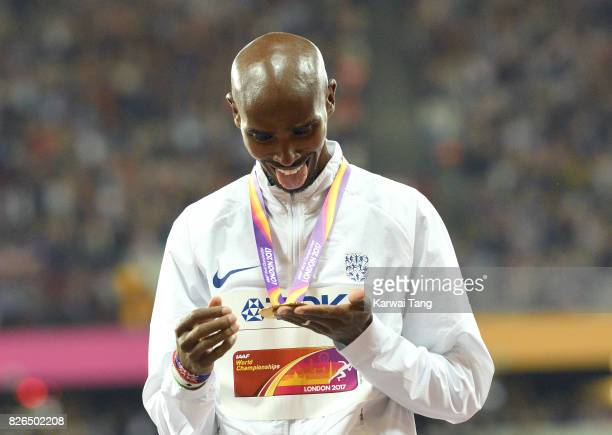 Mo Farah of Great Britain celebrates with his gold medal after winning the men's 10000 meters during the IAAF World Athletics Championships at the...