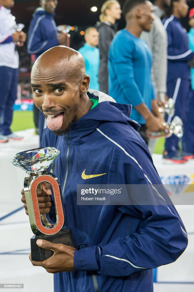 Mo Farah of Great Britain celebrates with the diamond trophy during the Diamond League Athletics meeting 'Weltklasse' on August 24, 2017 at the Letziground stadium in Zurich, Switzerland.