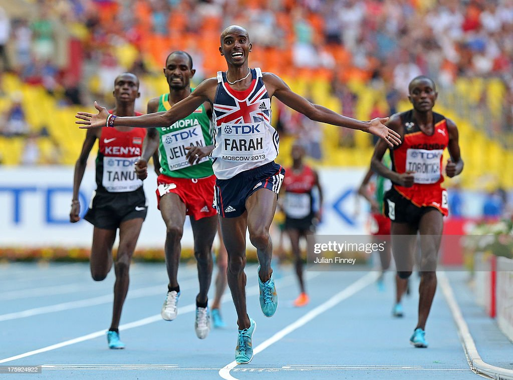 Mo Farah of Great Britain crosses the line to win gold in the Men's 10000 metres final during Day One of the 14th IAAF World Athletics Championships Moscow 2013 at Luzhniki Stadium on August 10, 2013 in Moscow, Russia.