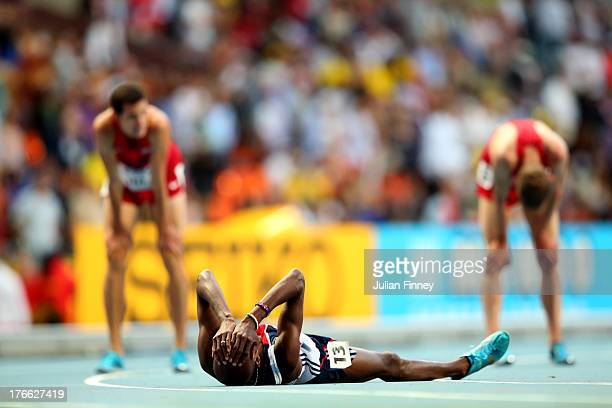Mo Farah of Great Britain crosses the Line to win gold in the Men's 5000 metres final during Day Seven of the 14th IAAF World Athletics Championships...