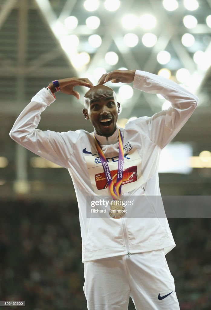Mo Farah of Great Britain does the mobot as he celebrates with his gold medal after winning the Men's 10000 metres final during day one of the 16th IAAF World Athletics Championships London 2017 at The London Stadium on August 4, 2017 in London, United Kingdom.