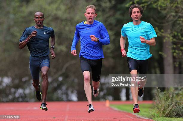 Mo Farah of Great Britain Galen Rupp of the USA and Cam Levins of Canada members of the Oregon Project train on the track at the Nike campus on April...