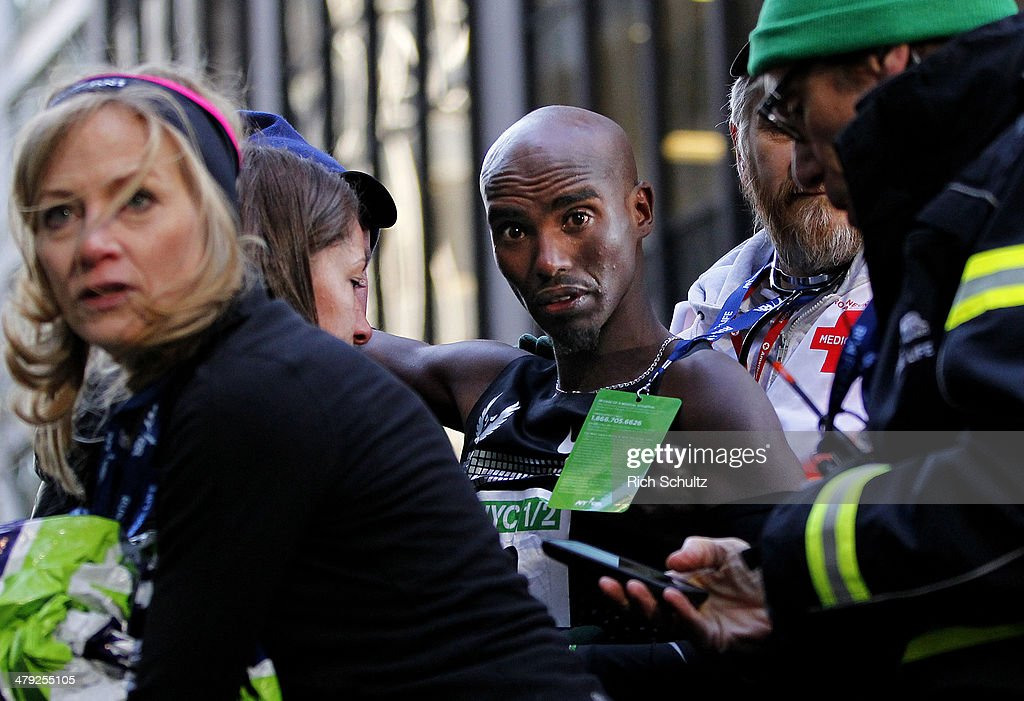 <a gi-track='captionPersonalityLinkClicked' href=/galleries/search?phrase=Mo+Farah&family=editorial&specificpeople=4819130 ng-click='$event.stopPropagation()'>Mo Farah</a> of Great Britain is helped back up after he collapsed at the finish line after finishing in second place at the 2014 New York City Half Marathon in lower Manhattan on March. 16, 2014 in New York City.