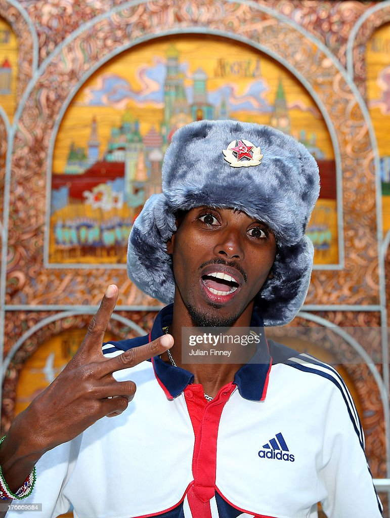 Mo Farah of Great Britain poses for a photo at the Crowne Plaza Hotel following his second Gold medal win in the 5000m at Luzhniki Stadium on August...
