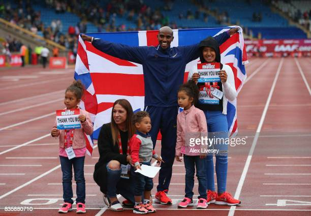 Mo Farah of Great Britain poses with his family after winning the 3000m at the Muller Grand Prix Birmingham meeting at Alexander Stadium on August 20...