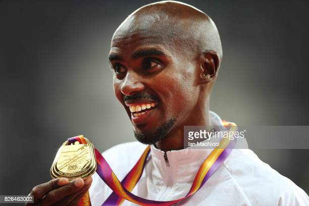 Mo Farah of Great Britain poses with his gold medal from the Men's 10000m final during day one of the 16th IAAF World Athletics Championships London...