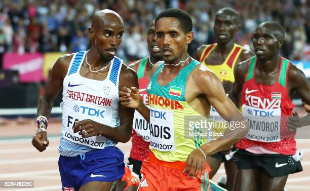 Mo Farah of Great Britain runs past Abadi Hadis of Ethiopia in the Men's 10000 metres final during day one of the 16th IAAF World Athletics...