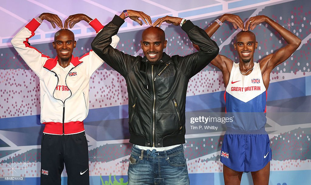 <a gi-track='captionPersonalityLinkClicked' href=/galleries/search?phrase=Mo+Farah&family=editorial&specificpeople=4819130 ng-click='$event.stopPropagation()'>Mo Farah</a> (C) poses for a photocall to unveil his two waxworks, one of which will be displayed in London and the other in Blackpool at Madame Tussauds on April 14, 2014 in London, England.