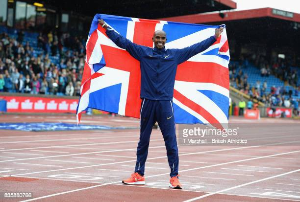 Mo Farah poses with the Union Flag after winning the men's 3000m during the Muller Grand Prix and IAAF Diamond League event at Alexander Stadium on...