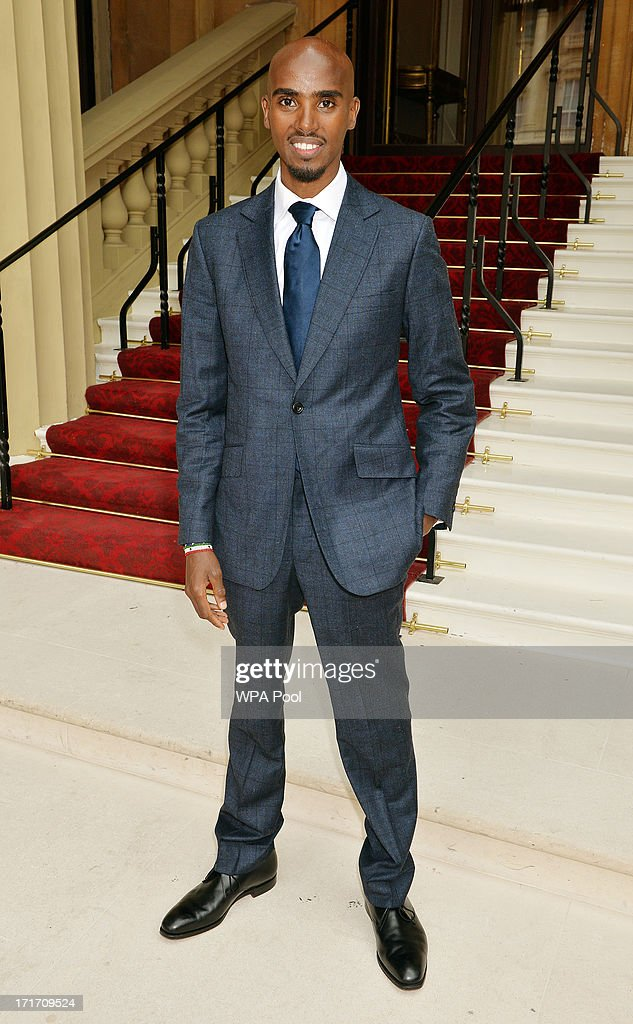 Mo Farrah, double Olympic Gold Medallist arrives for the Investiture ceremony at Buckingham Palace on June 28, 2013 in London, England. Mo Farah will receive an CBE for services to Athletics.