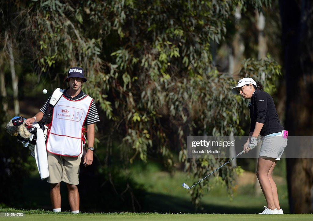 Mo Martin hits onto the 16th green as caddie watches during the Final Round of the LPGA 2013 Kia Classic at the Park Hyatt Aviara Resort on March 24, 2013 in Carlsbad, California.