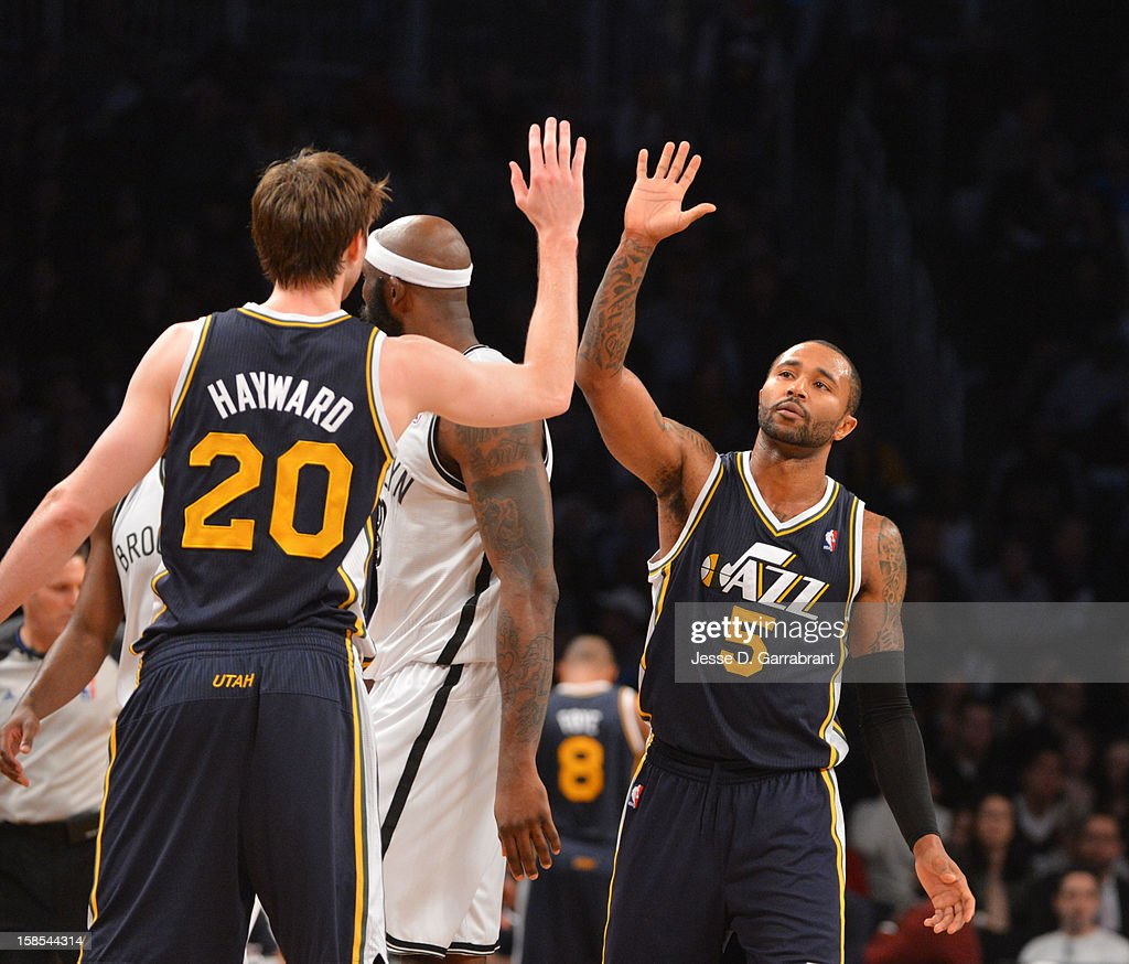 Mo Williams #5 and <a gi-track='captionPersonalityLinkClicked' href=/galleries/search?phrase=Gordon+Hayward&family=editorial&specificpeople=5767271 ng-click='$event.stopPropagation()'>Gordon Hayward</a> #20 of the Utah Jazz celebrate during the game against the Brooklyn Nets at the Barclays Center on December 18, 2012 in Brooklyn, New York.