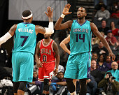 Mo Williams and Michael KiddGilchrist of the Charlotte Hornetsduring the game against the Chicago Bulls at the Time Warner Cable Arena on March 13...