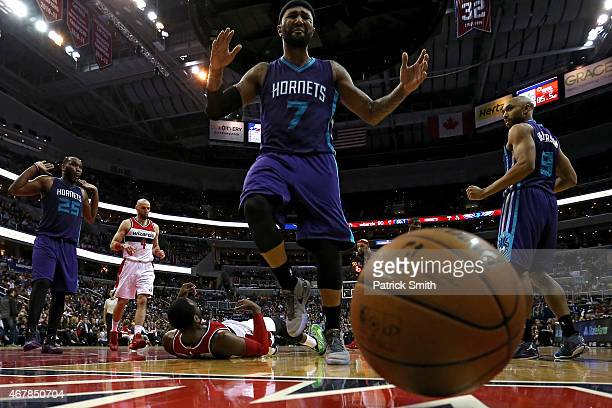 Mo Williams of the Charlotte Hornets chases a loose ball out of bounds after stripping the ball from John Wall of the Washington Wizards in the...