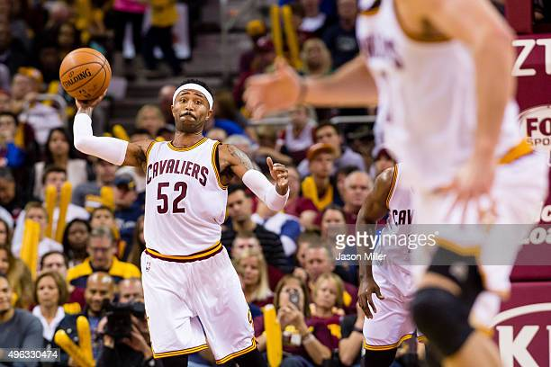 Mo Williams of the Cleveland Cavaliers makes a cross court pass to Kevin Love of the Cleveland Cavaliers during the second half at Quicken Loans...