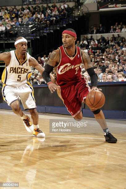 Mo Williams of the Cleveland Cavaliers moves the ball up court past TJ Ford of the Indiana Pacers during the game at Conseco Fieldhouse on April 13...