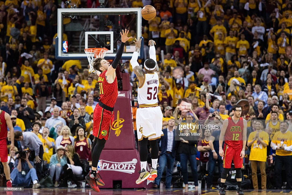 Mo Williams of the Cleveland Cavaliers shoots makes the 25th three point shot over Mike Muscala of the Atlanta Hawks during the second half of the...