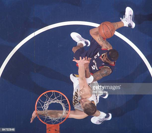 Mo Williams of the Cleveland Cavaliers shoots over Rasho Nesterovic of the Indiana Pacers at Conseco Fieldhouse on February 10 2009 in Indianapolis...