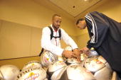 Mo Williams of the East AllStars autographs basketballs prior to the East AllStars practice on center court during NBA Jam Session Presented by...