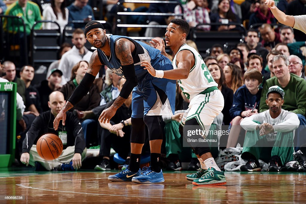 Mo Williams of the Minnesota Timberwolves handles the ball against Phil Pressey of the Boston Celtics on December 19 2014 at the TD Garden in Boston...