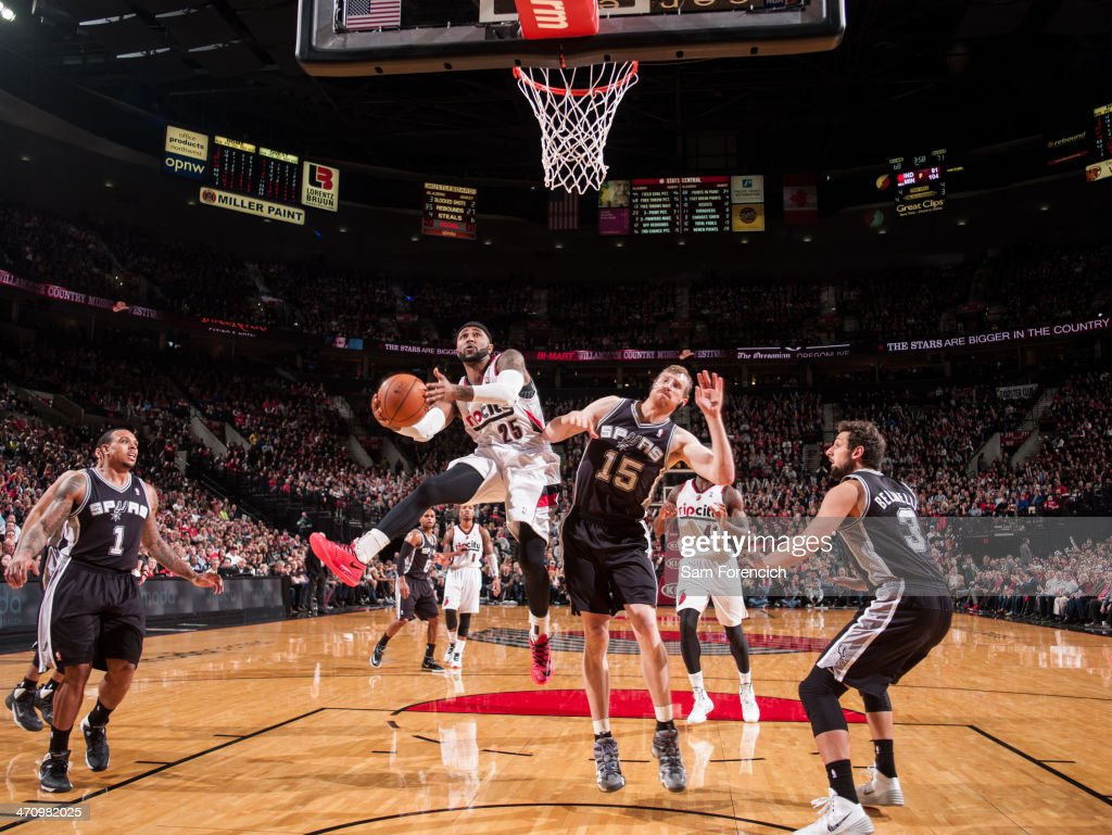 Mo Williams #25 of the Portland Trail Blazers drives to the basket against the San Antonio Spurs on February 19, 2014 at the Moda Center Arena in Portland, Oregon.