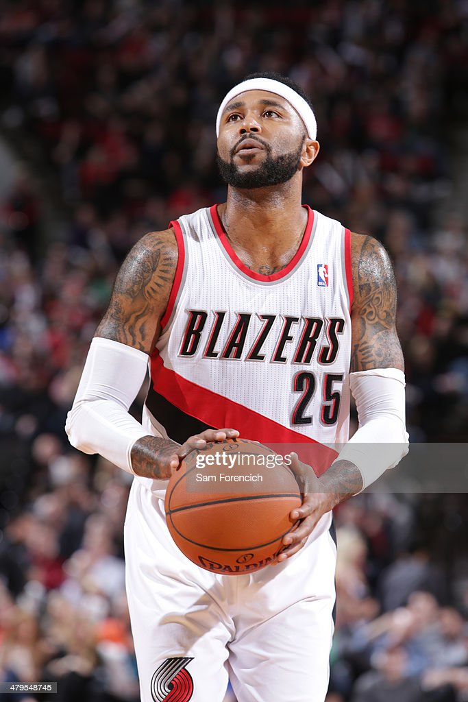 Mo Williams #25 of the Portland Trail Blazers shoots a foul shot against the Milwaukee Bucks on March 18, 2014 at the Moda Center Arena in Portland, Oregon.