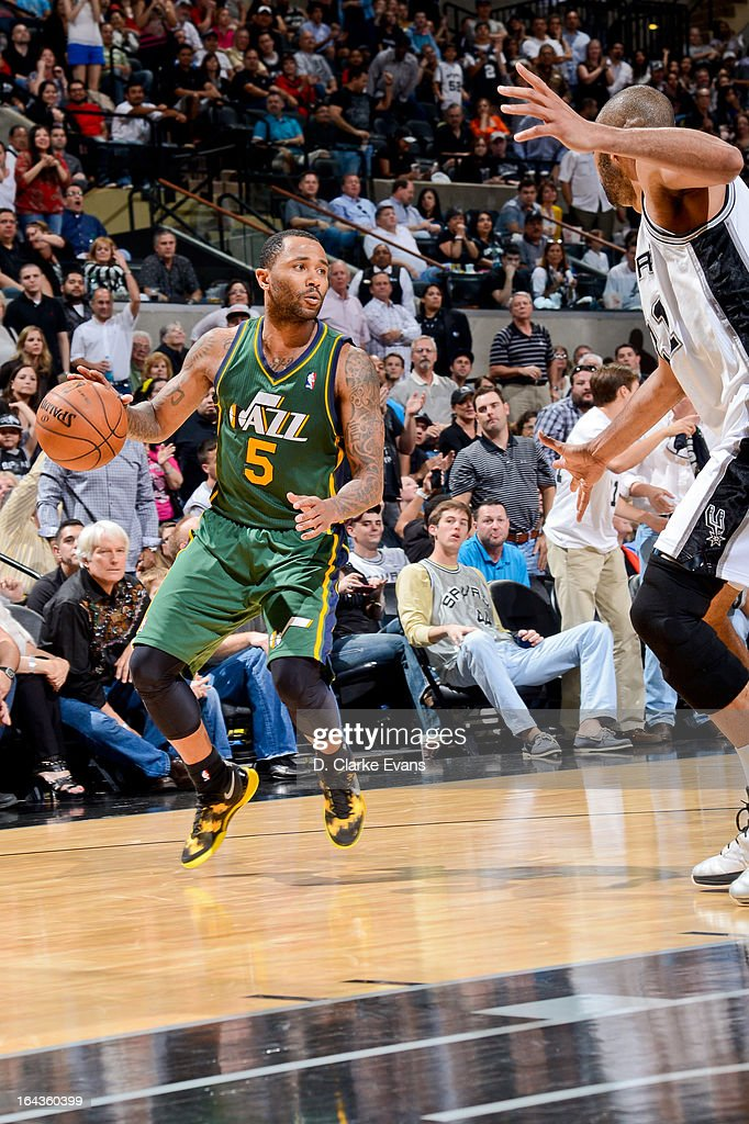 Mo Williams #5 of the Utah Jazz advances the ball against the San Antonio Spurs on March 22, 2013 at the AT&T Center in San Antonio, Texas.