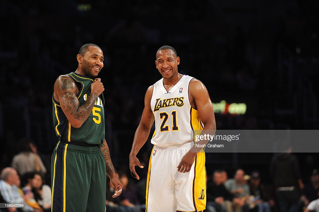Mo Williams #5 of the Utah Jazz and Chris Duhon #21 of the Los Angeles Lakers share a laugh in their game at Staples Center on December 9, 2012 in Los Angeles, California.
